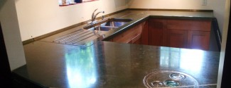 molded-stone-concrete-countertop-green-glass-inlay